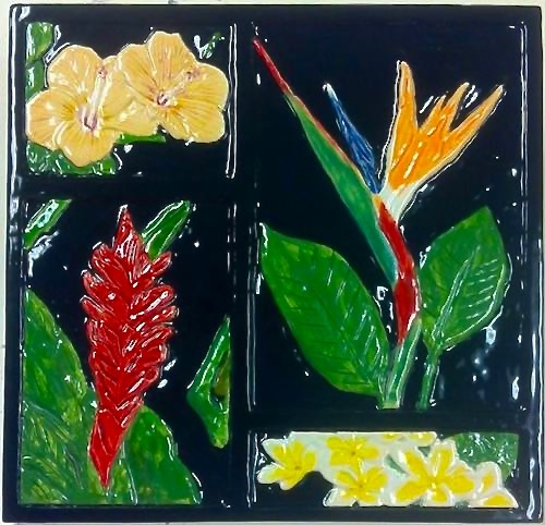 Clockwise from upper left: hibiscus, bird of paradise, plumeria and red ginger